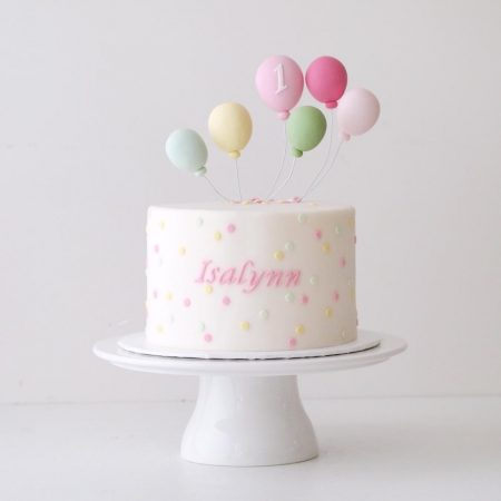 Baby Birthday Cake with Confetti and Balloons